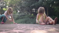 Three sisters drawing on pavement with chalk video