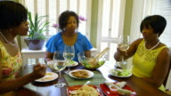 Three sisters enjoy a little lunch party together video
