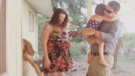 Three sisters excitedly greet their dad when he gets home from work video