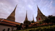 Three Stupas of Wat Pho Buddhism Temple Bangkok Night-to-Day Pedestal Timelapse video