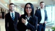 Three successful businessmen look in the camera video