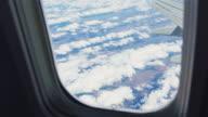 Three videos of airplane window in 4k video