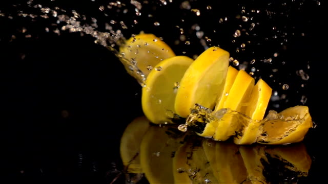 Three videos of falling lemon slices in real slow motion video