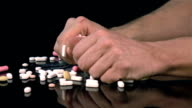 Three videos of grabbing pills in real slow motion video