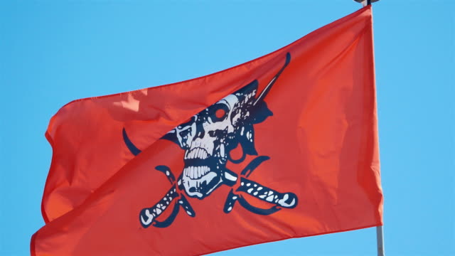 Three videos of red pirate flag in 4K video