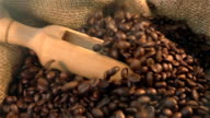 Three videos of scooping coffee beans in real slow motion video
