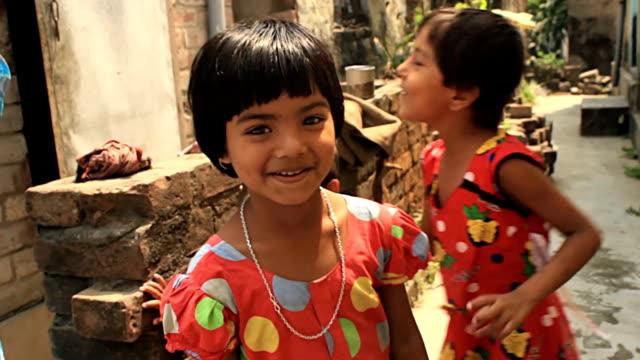 Three village children play. video