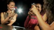 Three women at cocktail bar video