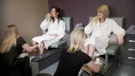 Three women get a foot treatment video