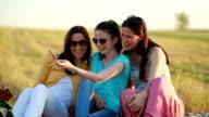 Three women taking selfie outdoors video