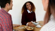 Three Young Business People in Discussion at Cafe video