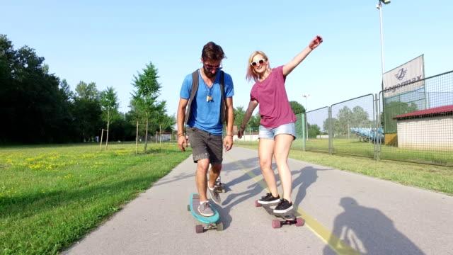 Three young people having fun skateboarding video