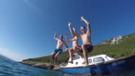 POV Three young people jumping off boat into the sea video