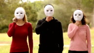 three young people with mask video