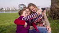 Three Young Teenage Girls, sisters, blond hair, taking Selfies outdoors video