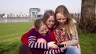 Three Young Teenage Girls, three sisters, smartphone screen, taking selfies video