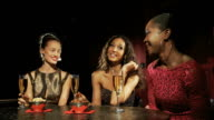 Three young women in a cocktail bar video