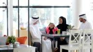 Three-generation Emirati family at cafe video