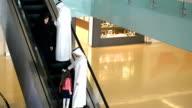 Three-generation Emirati family on escalator video