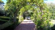 Through landscaped gardens video