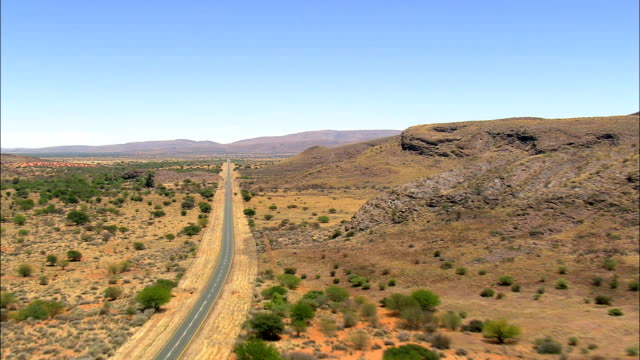 R64 through Langberg Hills  - Aerial View - Northern Cape,  Pixley ka Seme District Municipality,  Siyancuma,  South Africa video