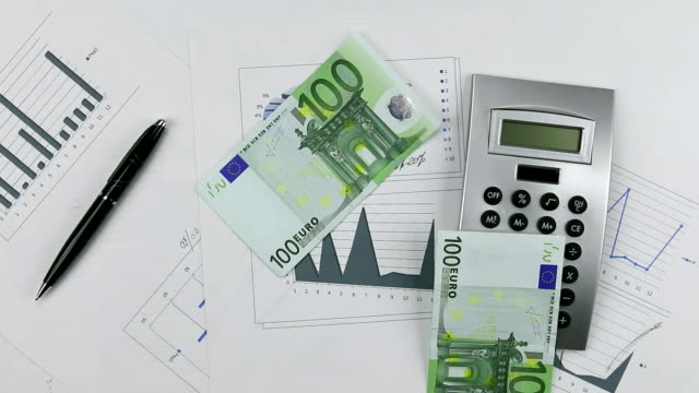 Throw euro on the chart with calculator and pen. Throwing Money down table video