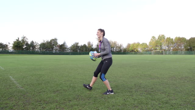 Throwing a Rugby Ball to her Coach video