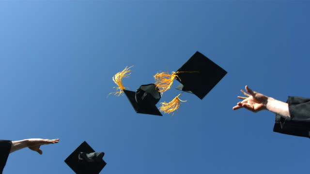 Throwing graduation caps into the air video