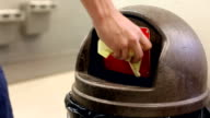 Throwing pieces of paper into trash can video