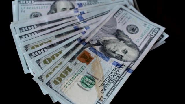 throwing, putting, giving, gathering dollars video