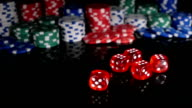 Throwing red dice on the background of poker chips. 3 video