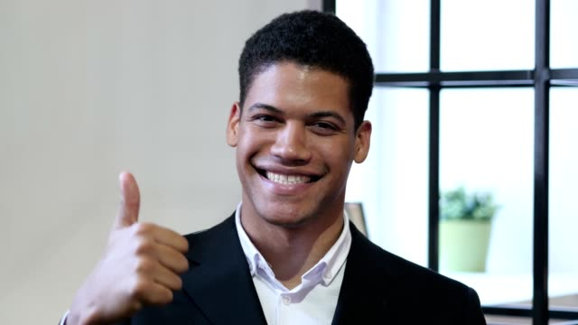 Thumbs Up by Black Businessman video