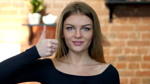 Thumbs Up By Young Girl, Portrait video