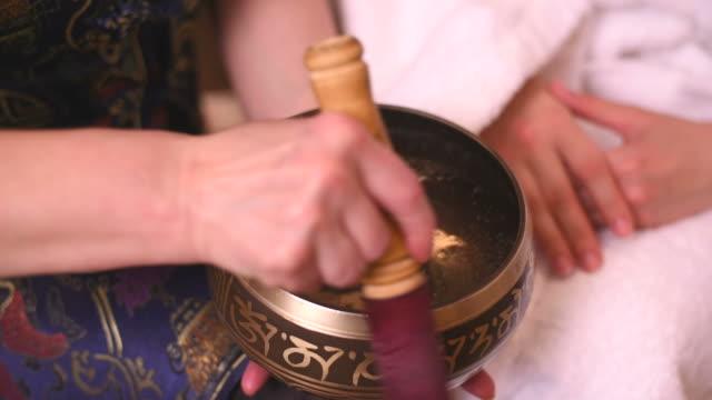 Tibetan singing bowls in action video