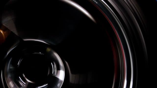 tight shot of car wheel spinning video