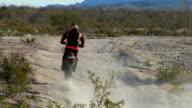Tight shot of motorbike wheels in desert video