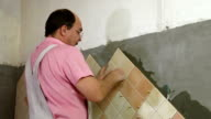 Tile Worker Wipes Grout video