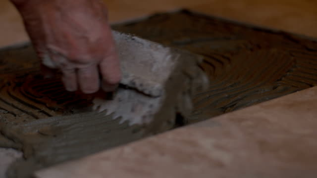 Tiler spreading tile adhesive video