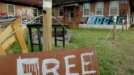 Tilt Down From Foreclosed, Vandalized Home to Free Sign video