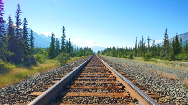 Tilt Down Shot, Blue Sky and Train Tracks Leading to Horizon video