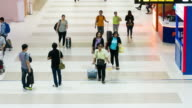 LS T/L tilt down: Traveler crowded walking at Airport Departure Hall video