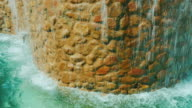 Tilt shot: Decorative waterfall. Landscaping of houses and hotels video
