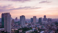 Tilt shot of Bangkok city skyline time lapse from day to night video