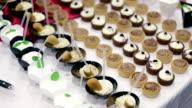 HD: Tilt shot table full of desserts video