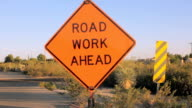 Tilt to Reveal a Road Work Ahead Sign video