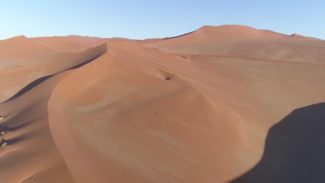 Tilt up aerial view of  one of the vast sand dunes in the Namib desert video