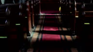 Tilt Up Church Aisle Red Carpet to Altar and Stained Glass Window - Religious Beautiful Art Backgrounds video