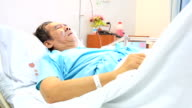 HD Tilt up crane shot: Patient in Hospital video