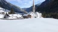 Tilt up: St. Sigismund im Sellrain, Tyrol, Austria, in winter video