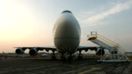 Tilt up to front view of Jumbo Jet at dawn video